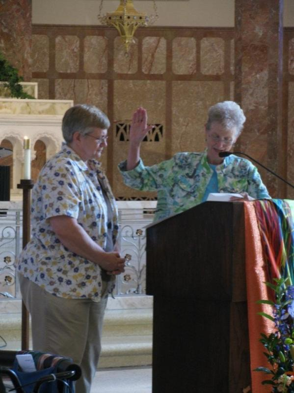 IHM Candidate Diane Brown receives a blessing from Sister Mary Bea Keeley, IHM